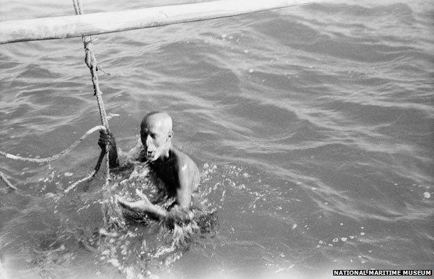 A diver draws breath. photograph taken by Alan Villiers