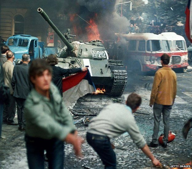 Prague residents throw burning torches to stop a Soviet tank in Prague August 1968