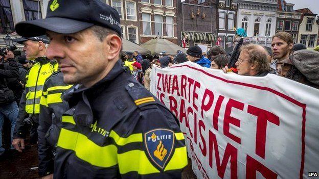 Dutch police form a line around a protest against Black Pete, Gouda, The Netherlands, 15 November 2014