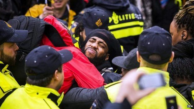 Members of the police and demonstrators clash during anti-Black Pete demonstration, Gouda, The Netherlands, 15 November 2014