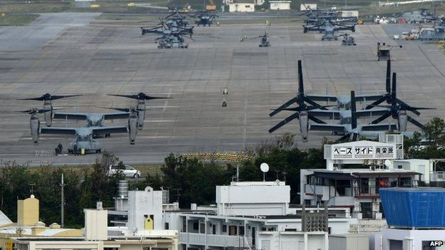 Multi-mission tiltrotor Osprey aircraft sit at the US Marine's Camp Futenma in a crowded urban area of Ginowan, Okinawa prefecture, 14 November 2014