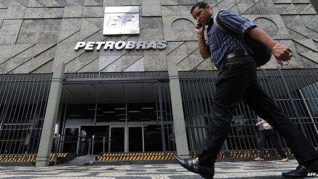 A man walks past the Petrobras building in Rio de Janeiro, Brazil, January 4, 2011.