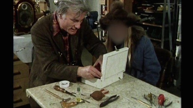 Keith Harding shows a young girl how a music box works