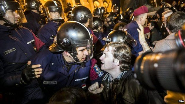 One of the demonstrators in dialogue with a riot police officer in Budapest, Hungary on 17 November 2014