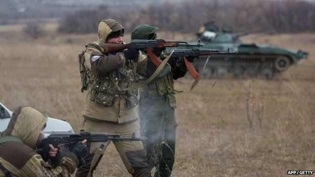 Pro-Russian militants test fire in an open field, in the eastern Ukrainian town of Ilovaisk on 18 November 2014