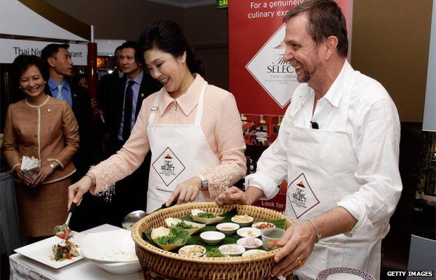 Prime Minister of Thailand, Ms Yingluck Shinawatra and Australian chef David Thompson cook traditional Thai food during a Thai food promotion and cooking demonstration at the Shangri-La Hotel on 27 May 2012 in Sydney, Australia