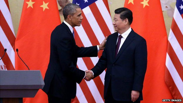 US President Barack Obama shakes hands with Chinese President Xi Jinping after a joint press conference at the Great Hall of People in Beijing - 12 November 2014