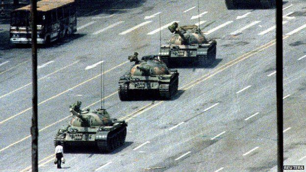 A Beijing citizen stands in front of tanks on the Avenue of Eternal Peace in this 5 June, 1989 file photo during the crushing of the Tiananmen Square uprising
