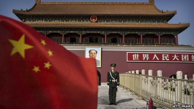 A Chinese soldier stands guard in front of Tiananmen Gate outside the Forbidden City on 27 October, 2014 in Beijing, China