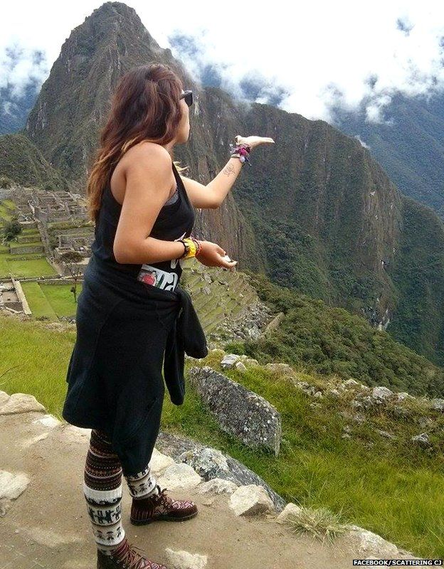 A woman scattering CJ's ashes over Machu Picchu, Peru