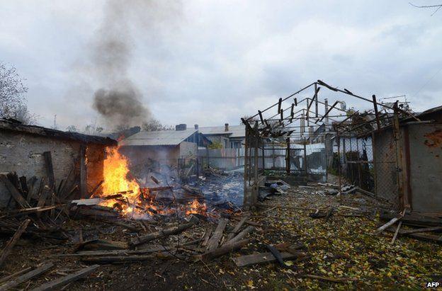 A building burns after rockets hit homes in rebel-held Donetsk. 18 October