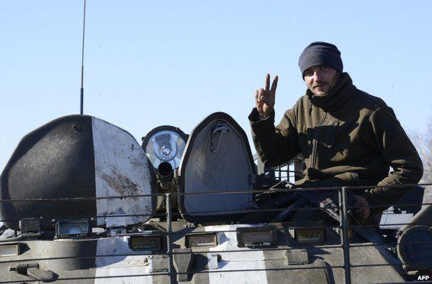 A Ukrainian soldier flashes a victory sign in Pavlopil, Donetsk region, 28 October