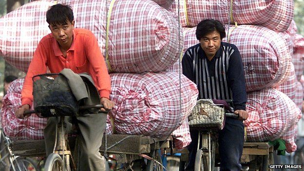 Cyclists with heavy loads in China