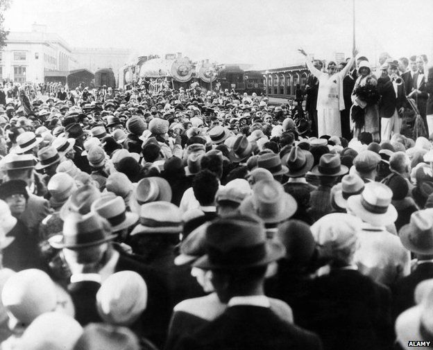 Aimee Semple McPherson (far right, standing with raised arms), c. 1930