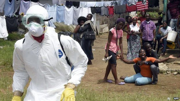 File photo: People look on as a woman reacts after her husband is suspected of dying from the Ebola virus, in the Liberian capital Monrovia, 4 October 2014