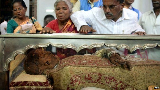 Indian Christians pay their respects to the Saint Francis Xavier at the Se Cathedral, Goa - 22 November 2014