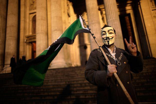 Occupy protester in V for Vendetta mask
