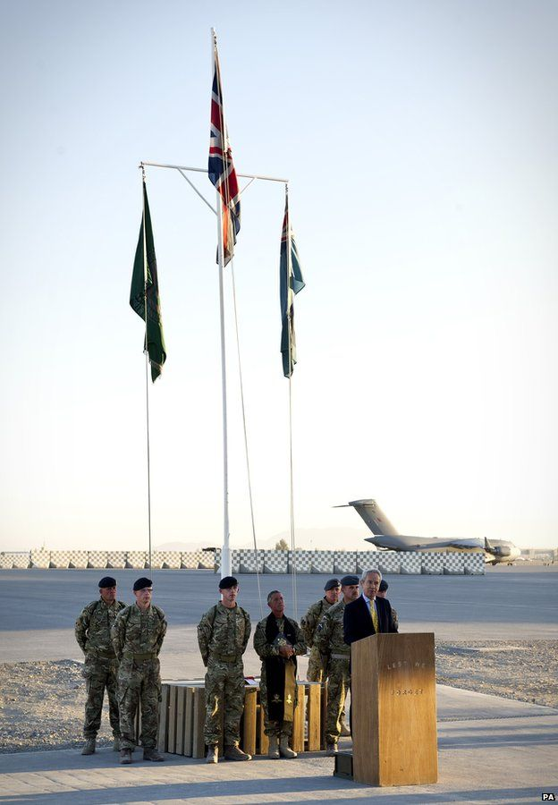 Sir Richard Stagg, British Ambassador to Afghanistan, saying the final few words before the lowering of the union flag at Kandahar Air Base, southern Afghanistan
