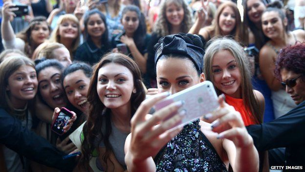 Katy Perry poses for selfies with fans