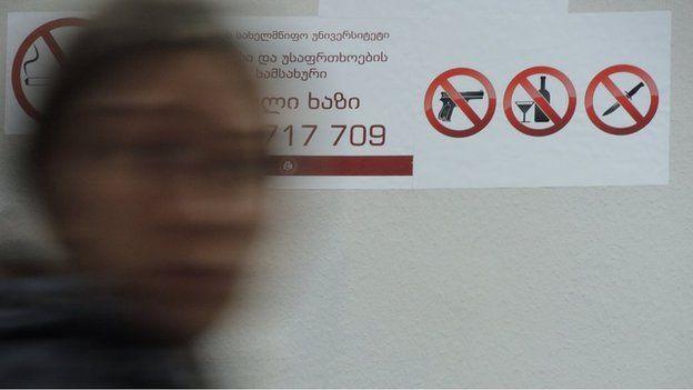 """""""No guns"""" sticker at Ilia University, Tbilisi"""