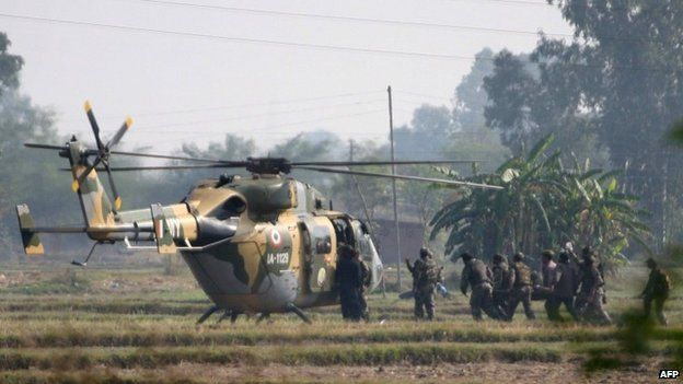 An Indian Army soldier allegedly injured during an encounter with militants is evacuated by helicopter in the village of Pindi near the Line of Control between India and Pakistan