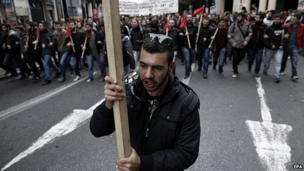 A protestor holds a banner in Greece
