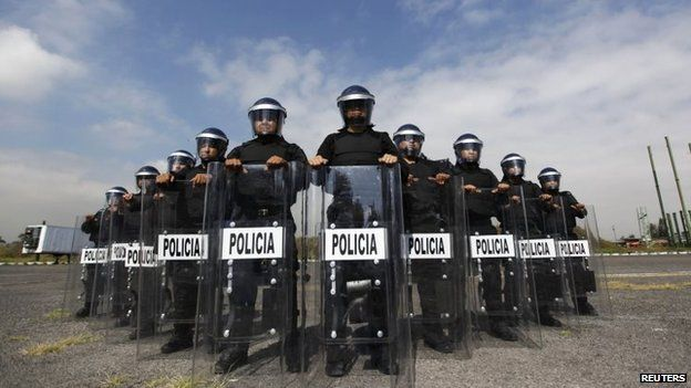 File photo: Members of the Task Force for Mexico City pose for a photograph at their base in Mexico City, 15 October 2014