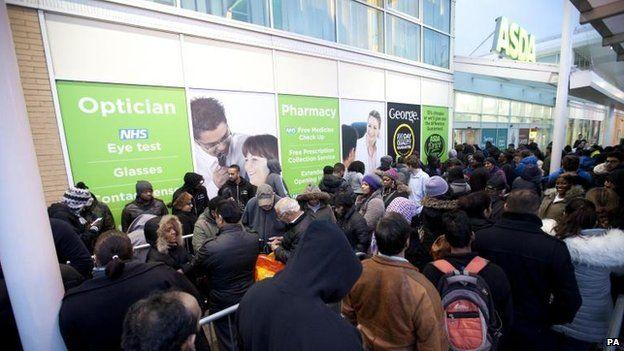 Shoppers queue outside Asda - Black Friday 2014