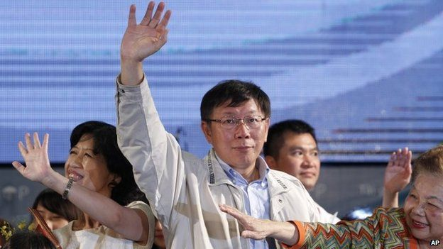 Taipei's new mayor Ko Wen-je waves to supporters at his campaign headquarters in Taipei in Taiwan,on 29 November 2014