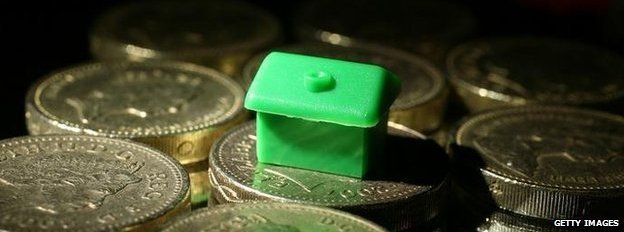 Monopoly piece on house