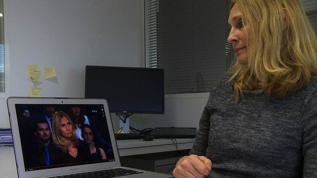 Karine Charbonnier-Beck looks at video of her performance on the TF1 programme Face aux Francais