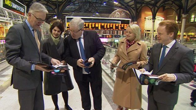 """Transport Secretary, Patrick McGloughlin, reads the """"Norwich in 90"""" campaign report"""