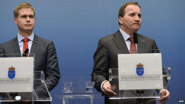 Sweden's Prime Minister Stefan Lofven (R) with Greens spokesman and Education Minister Gustav Fridolin