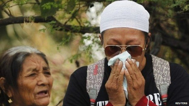 A woman with missing relatives is struck by grief during a religious mass before a search in a graves zone discovered in October outside Iguala, in Guerrero state on 29 November 2014.