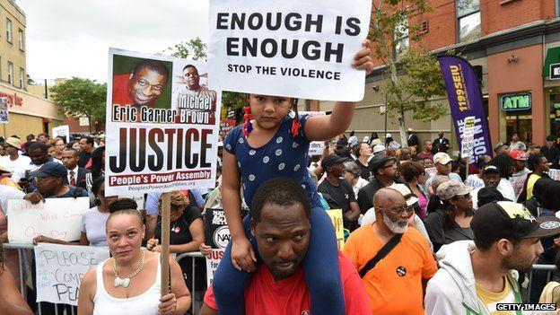 Demonstrators rallied against police brutality in memory of Eric Garner in New York on 23 August 2014