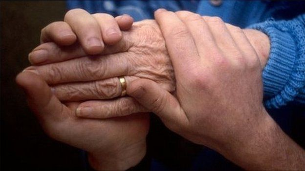 Holding hands with a cancer a patient