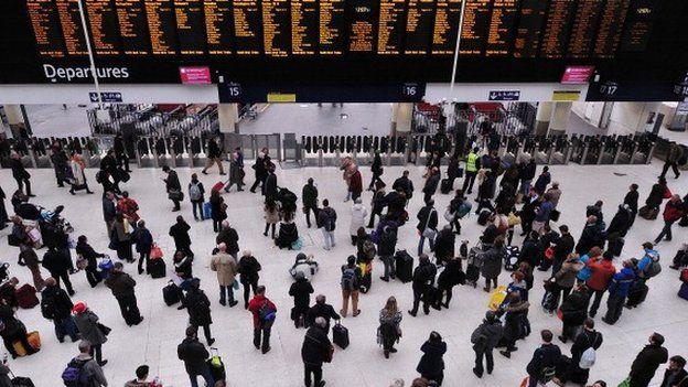 People in Waterloo train station in December 2013