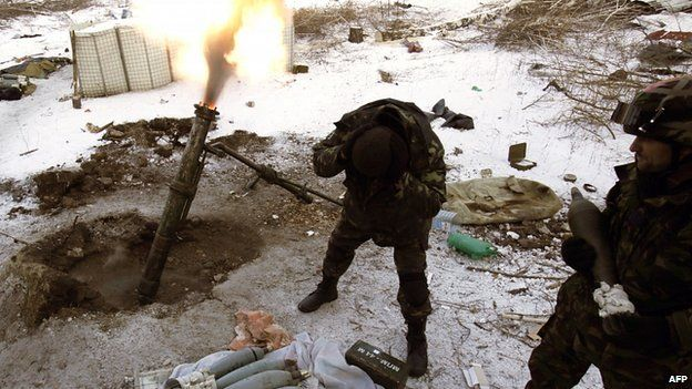 Ukrainian troops fire mortars at pro-Russian separatists at the village of Pisky near Donetsk airport. 5 Dec 2014
