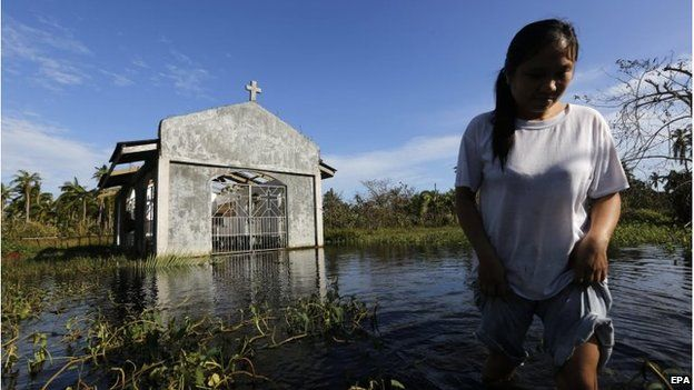 Ruined church amid flooding in Dolores, Philippines (8 Dec 2014)