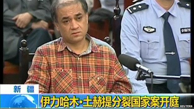 Uighur academic Ilham Tohti sits during his trial on separatism charges in Urumqi, Xinjiang region, in this still image taken from video shot on 18 September, 2014