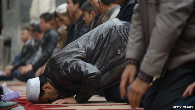 Muslim worshippers attend Friday prayers at a mosque in Beijing on 1 November, 2013