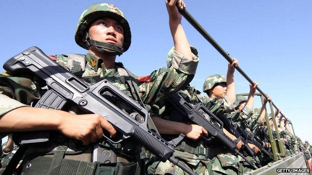 An anti-terrorism force including public security police and the armed police attend an anti-terrorism joint exercise in Hami, northwest China's Xinjiang region on 2 July, 2013