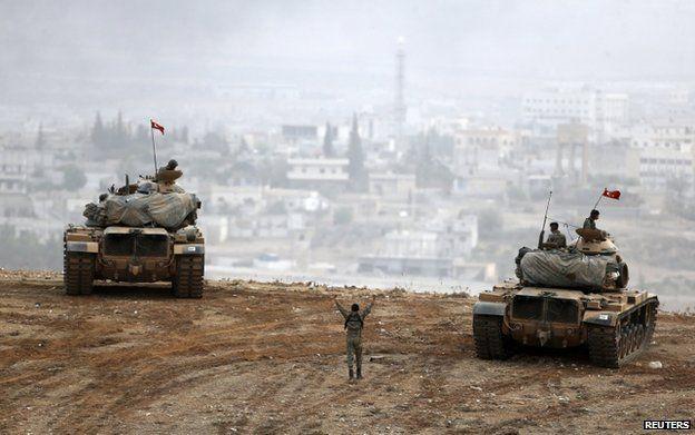 Turkish tanks face Kobani across the border with Syria, 11 October