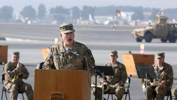 International Security Assistance Force, General John F. Campbell speaks during a flag-lowering ceremony in Kabul, Afghanistan, Monday, Dec. 8, 2014