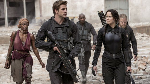 Liam Hemsworth and Jennifer Lawrence with other cast members of The Hunger Games: Mockingjay - Part 1