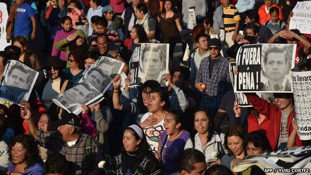 Protesters demand justice in the case of 43 missing students during a march in Mexico City.