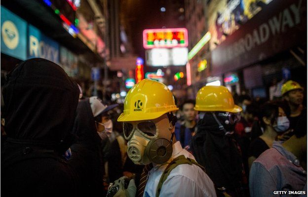 A pro-democracy activist is seen wearing a gas mask on a street in Mong Kok on November 26, 2014 in Hong Kong