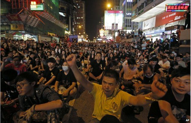 Thousands of pro-democracy protesters gather at Hong Kong's Mong Kok district Monday, Sept. 29, 2014