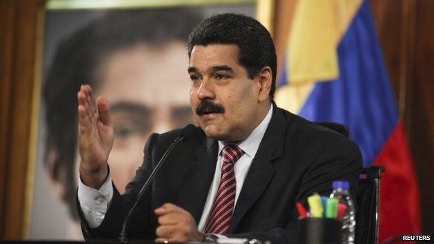 President Nicolas Maduro speaks during a cabinet meeting at Miraflores Palace in Caracas on 2 December, 2014