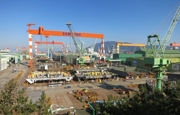 Buses and cars in the shipyard